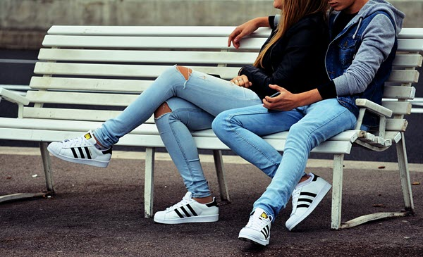 girl and guy sitting on bench friends with benefits TheHopeLine