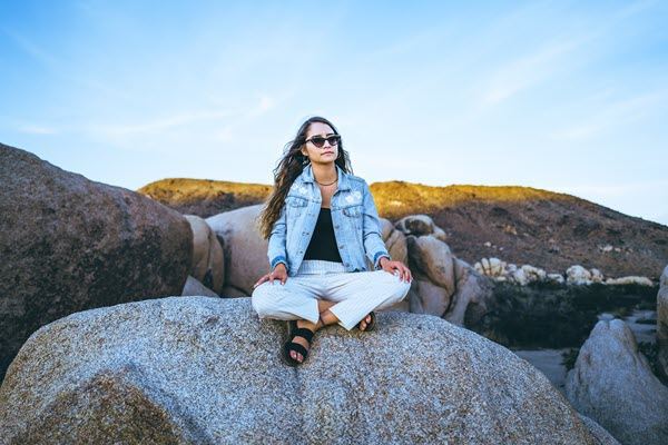 girl sitting outside on a rock I'm an addict and I felt all alone until i talked to a HopeCoach at TheHopeLine