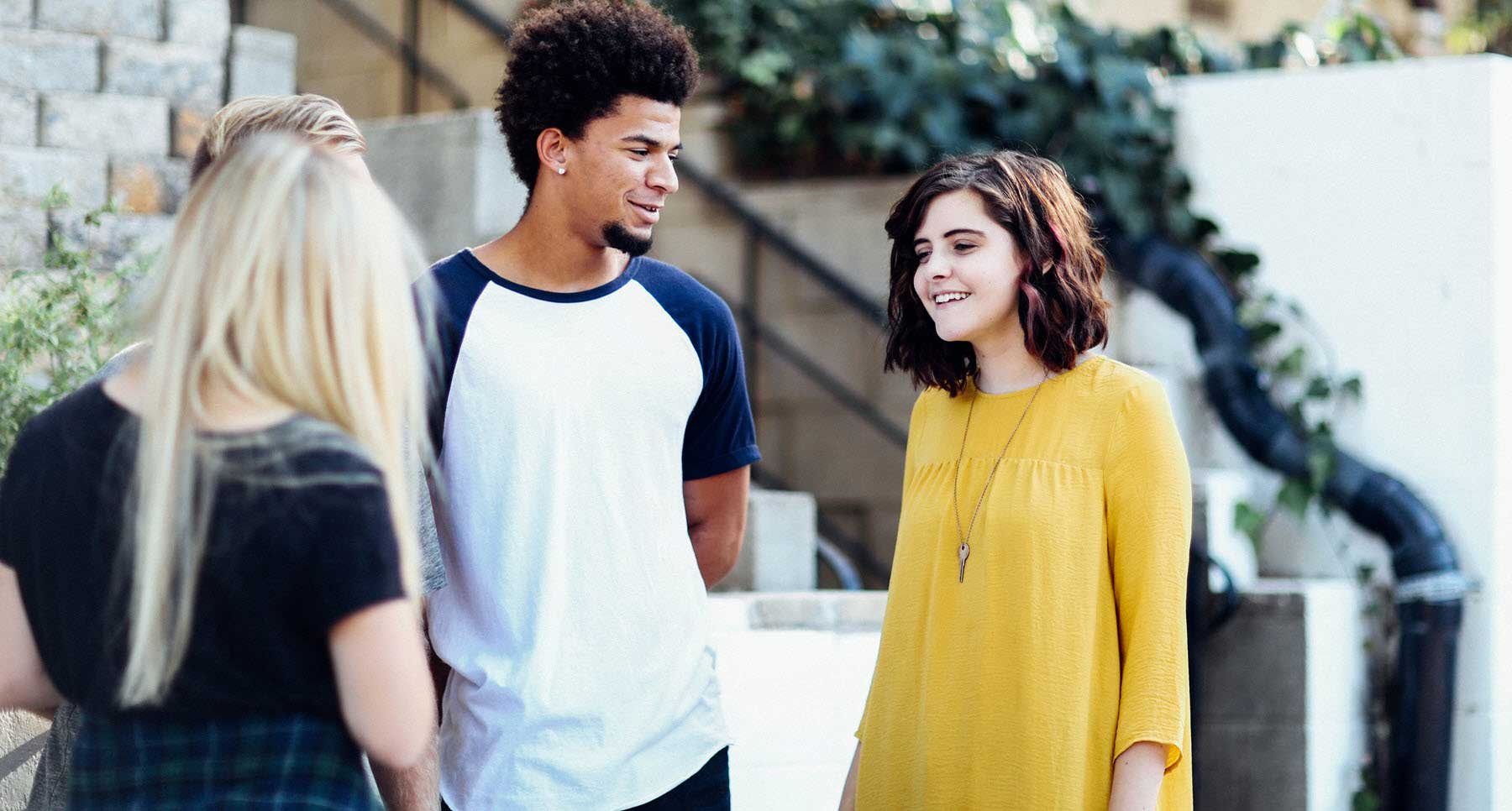 start-the-new-school-year-right-young-adults-outside-talking-about-the-best-school-year-ever