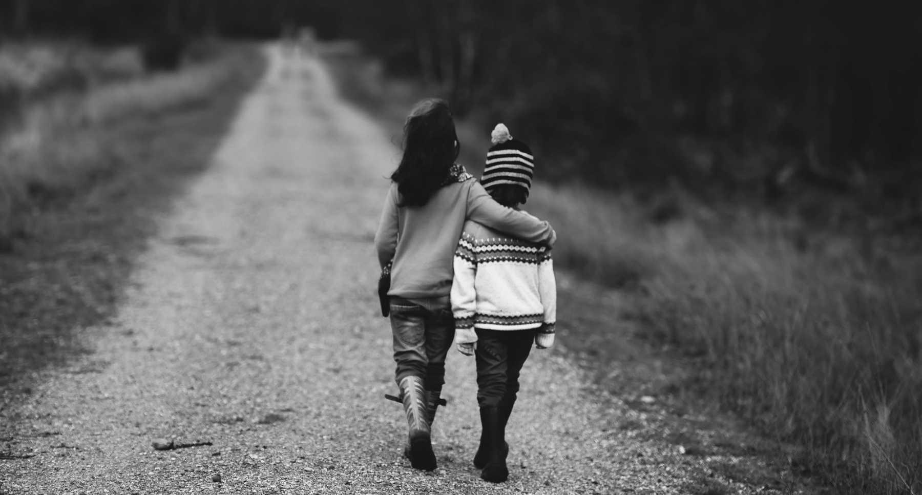 siblings walking away