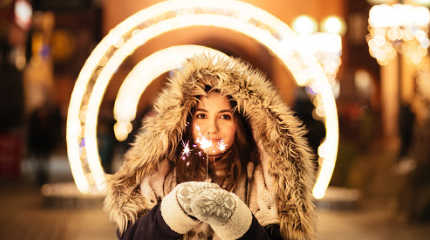 Girl in hood with sparkler