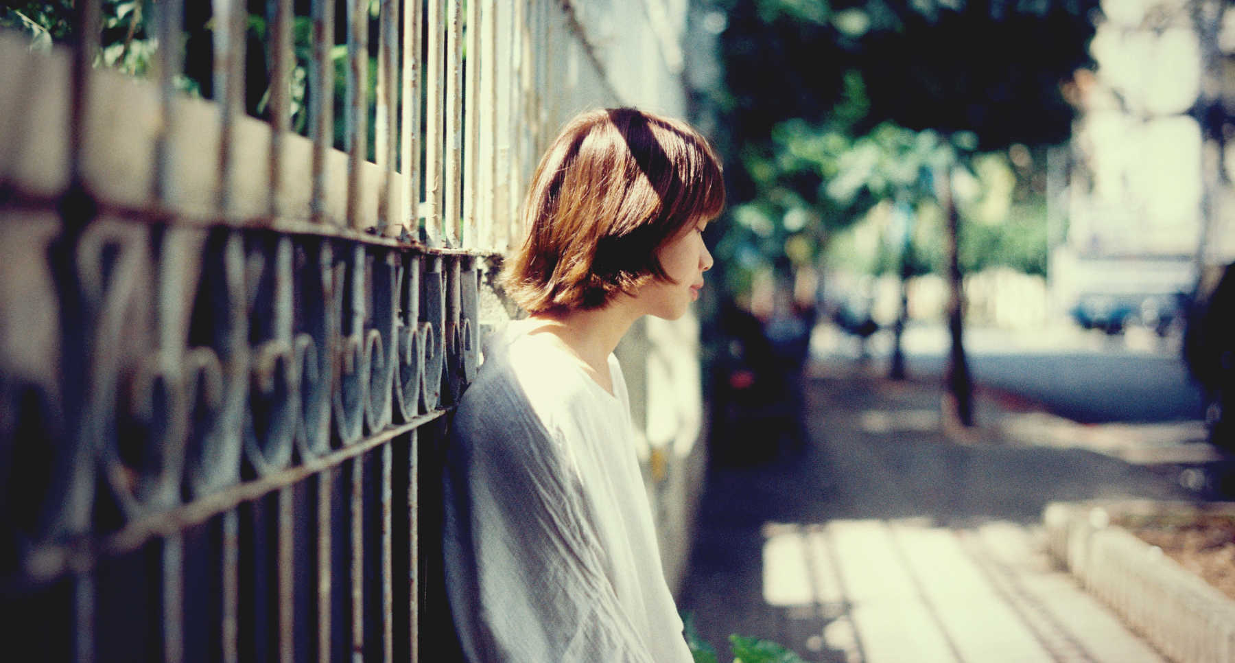 Sad girl by fence