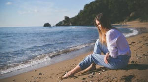 TheHopeLine-breakup-girl-sitting-on-the-beach-sad-from-a-breakup