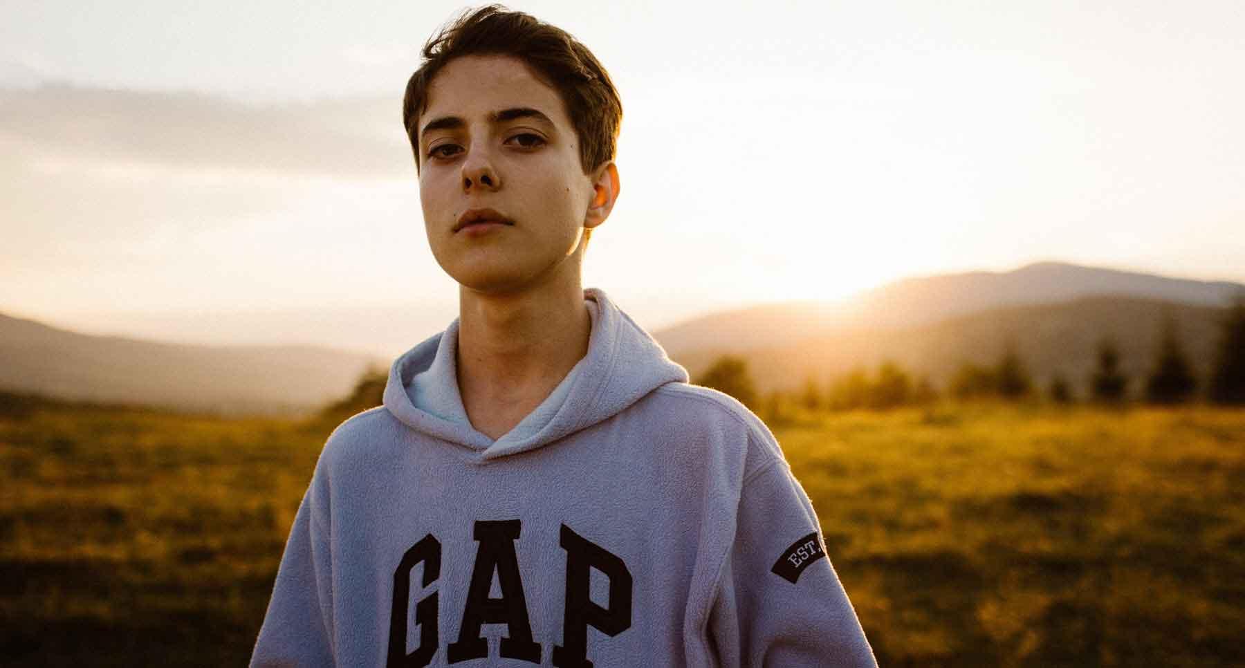teen-boy-standing-outside-dad-abandoned-left-him