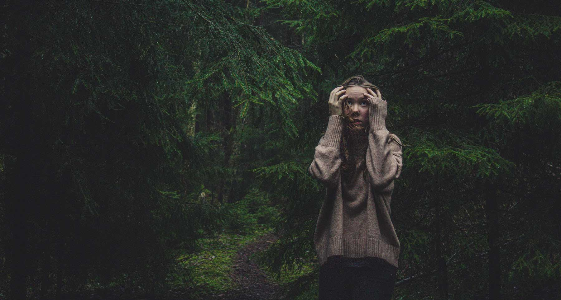 girl-in-the-woods-having-a-panic-attack