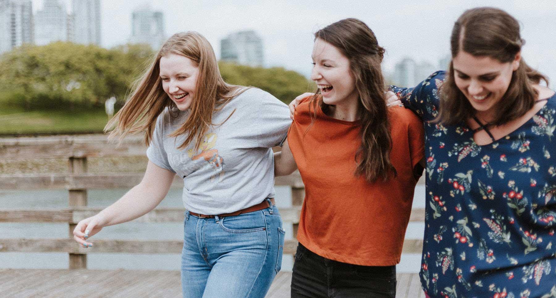 friends-outside-arm-in-arm-having-fun