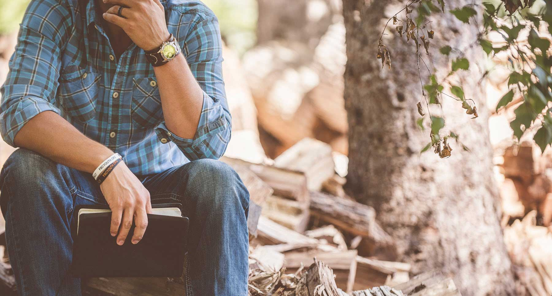 reading bible outside struggling with depression and anxiety pastor attempted suicide