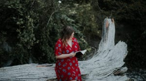 Heartbroken girl reading the Bible