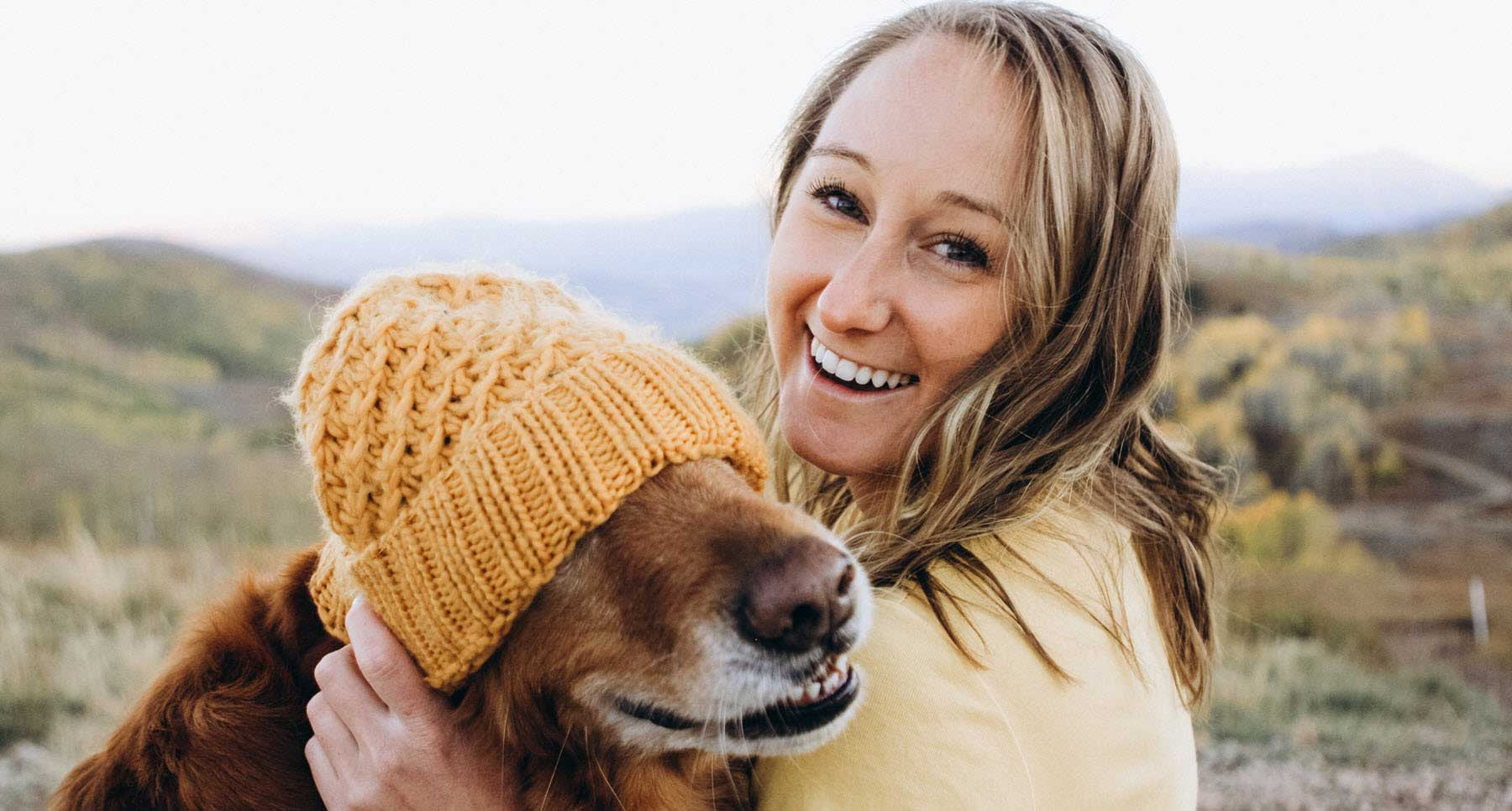 woman-outside-having-fun-with-her-dog-and-content-being-single
