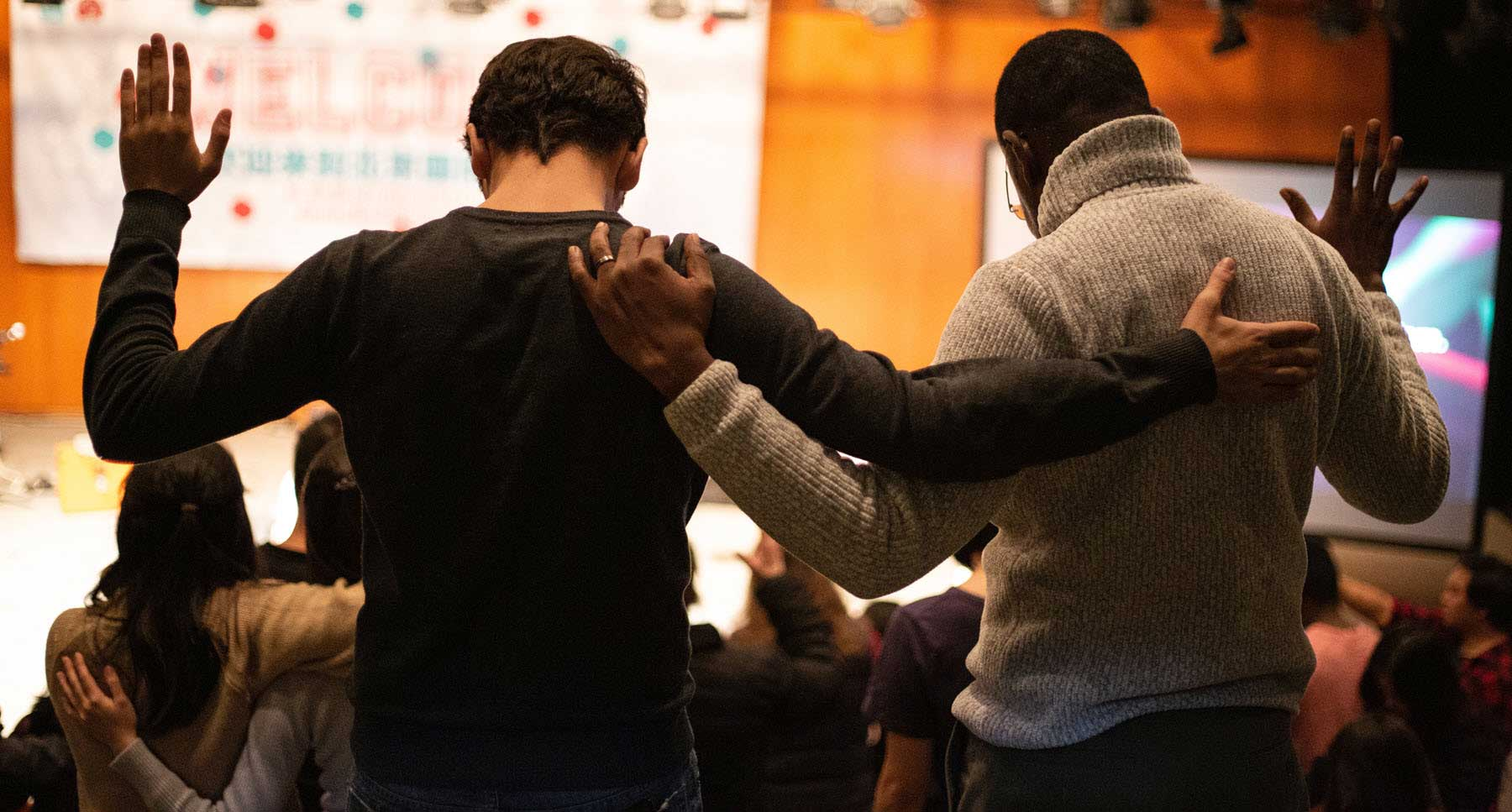 two-guys-praying-together-to-encourage-a-friend-in-their-faith