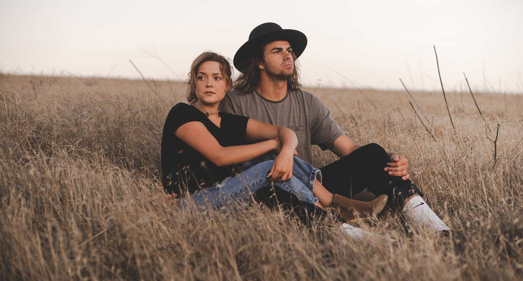 Is-Your-Partner-a-Narcissist-What-is-a-narcissist-Guy-and-girl-irritated-with-each-other-sitting-in-a-field-TheHopeLIne