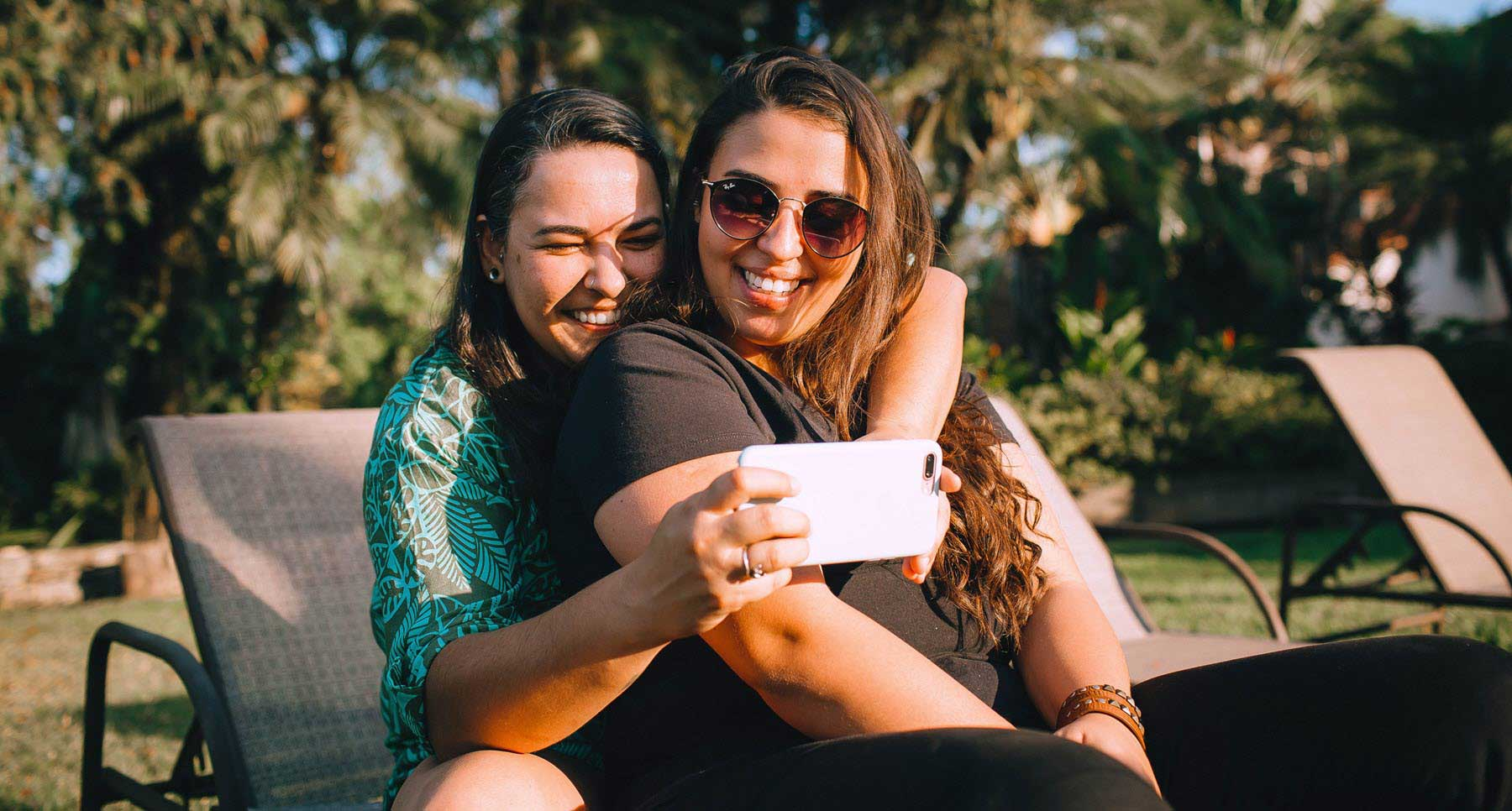 Two girls smiling taking a selfie