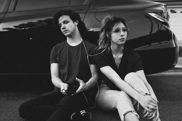 young couple outside sitting in front of a car Can You Get PTSD from an Abusive Relationship TheHopeLine