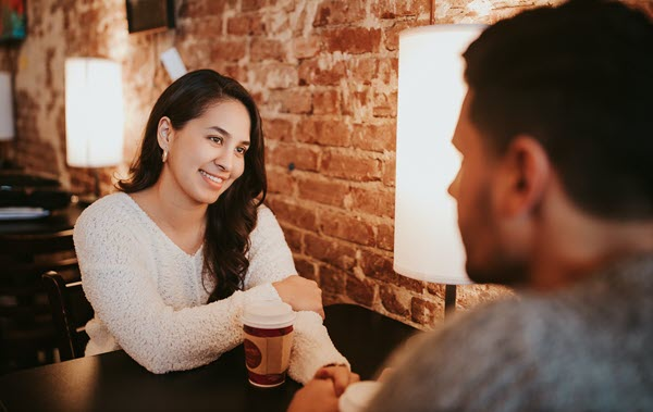 Woman on a first date in a coffee shop Are You Afraid to Be Single love addiction self esteem issues TheHopeLine
