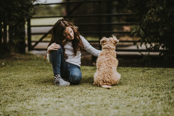 Sad girl with dog How to Forgive a Parent Who Abandoned You TheHopeLine
